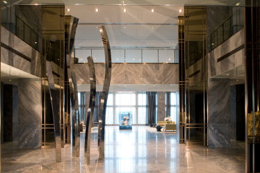 The Elegant Port Cochère Entrance Leads To A Grand Two Story Lobby